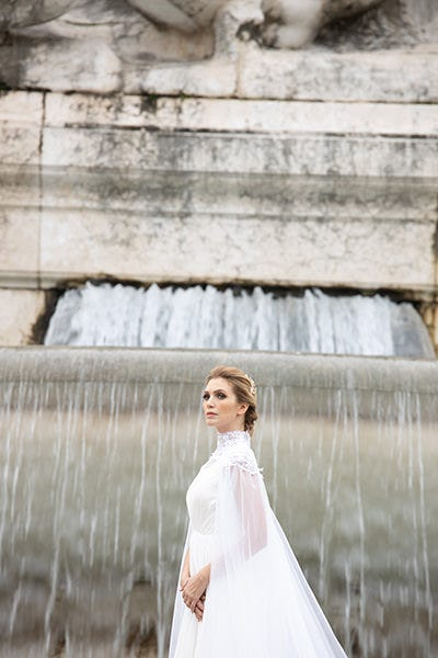Bride in front of a fountain